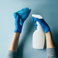 Sanitizer in human hand in gloves. Disinfection of premises and personal items.