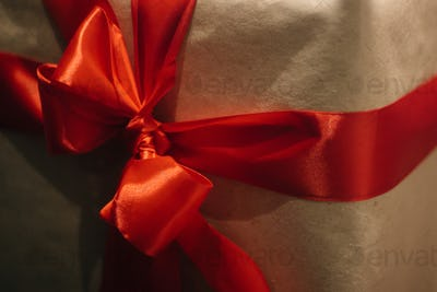 stylish craft gift boxes with red ribbons in window shop, seasonal holiday present concept
