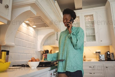 Woman spending time at home in her kitchen