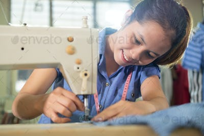 close up of a beautiful woman smiling while sewing