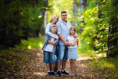 Happy family outdoor portrait in a forest