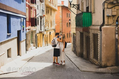 Couple with face masks on a pintoresque small village