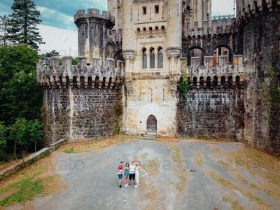 Group of friends in front of the Butron Castle in Vizcaya, Spain