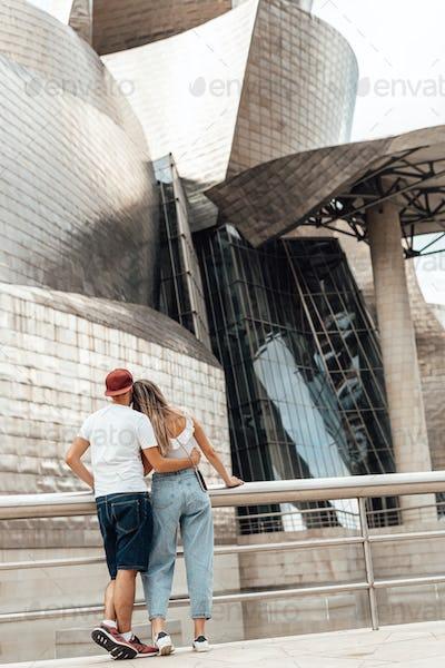 Couple visiting the Guggenheim museum in Bilbao