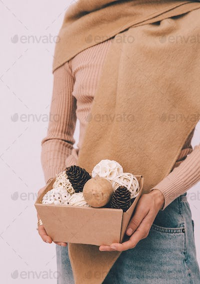 Young girl in  beige warm sweater