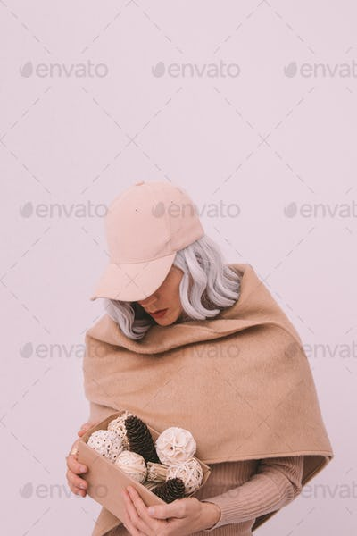 Young stylish girl in beige