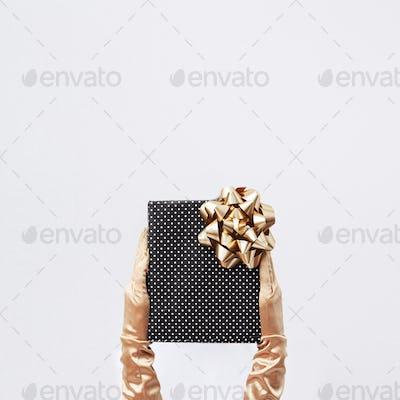 Hands in golden retro gloves