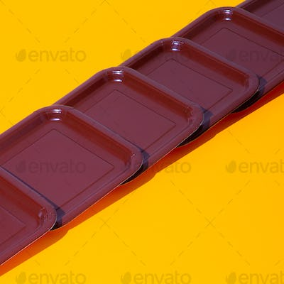Plastic plate in isometric on yellow background. Minimal. Still life art. Plastic free concept