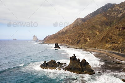 Rough rocky cliffs in the North of Tenerife. Beautiful Benijo beach in the Canary Islands. Rocks
