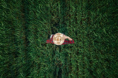 Aerial view of barley farmer standing in the field