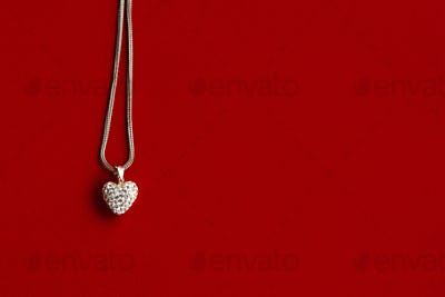 luxury heart necklace with stylish diamonds on red background
