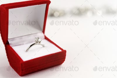 stylish luxury ring with diamond in red box on white background