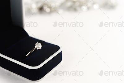 stylish luxury ring with diamond in blue box on white background