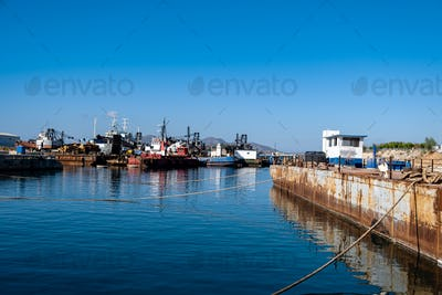 Ships and boats anchored in old port of Drapetsona Piraeus Greece, sunny day.