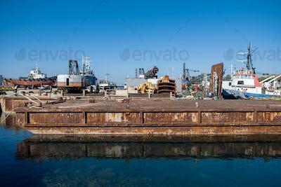 Old fertilizer industrial plant port in Drapetsona Piraeus Greece, sunny day.