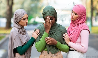 Arabic Ladies Comforting Unhappy Friend Supporting Her Standing Outside