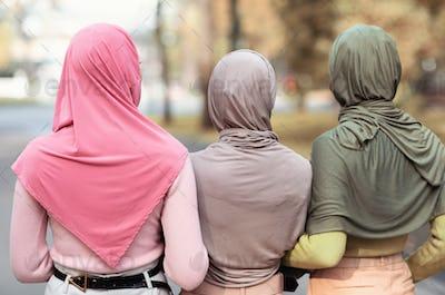 Three Unrecognizable Muslim Ladies In Hijab Walking Outdoor