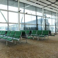 bench in waiting hall in airport