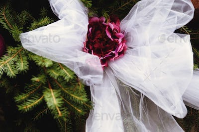 stylish decorated place with flowers and ribbons at the reception in a restaurant