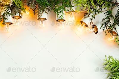 green branches of cedar or fir and amazing christmas golden vintage garland