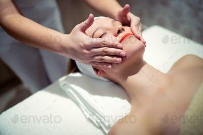 Rejuvenating relaxing massage by masseur