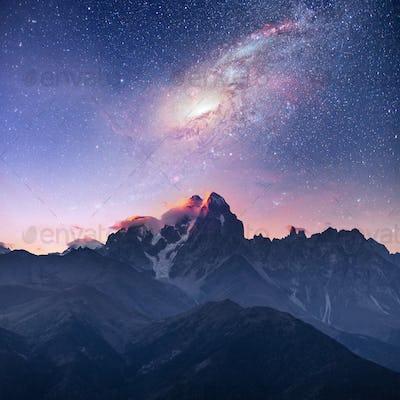 Fantastic starry sky. Snow-capped peaks. Main Caucasian Ridge. Courtesy of NASA. Mountain View from