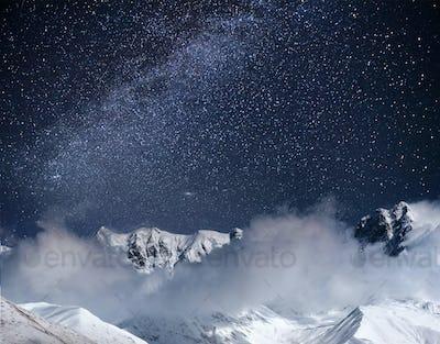 Fantastic starry sky. Thick fog on the mountain pass Goulet. Georgia, Svaneti. Europe. Caucasus