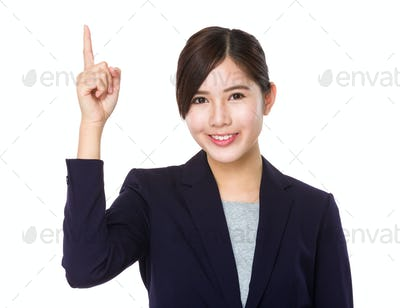 Asian young businesswoman finger point up