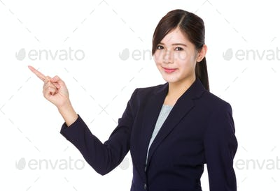Young businesswoman with finger showing up