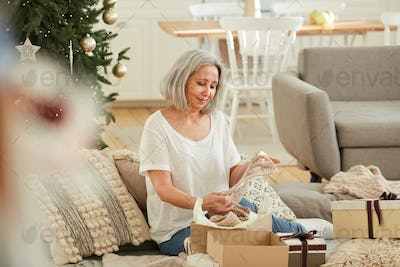 Woman looking at her present