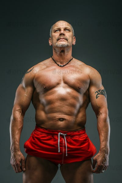 Strong muscular middle age man