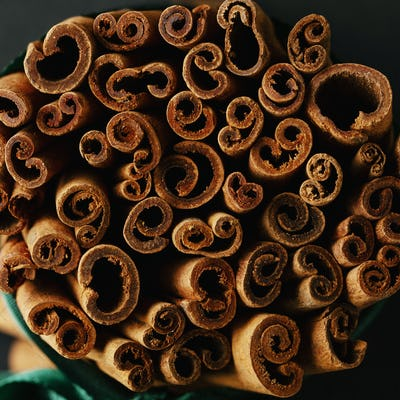 Bunch of cinnamon sticks with ribbon