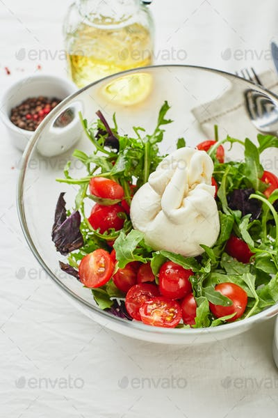 Burrata cheese with tomato, arugula and red basil salad