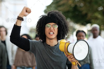 Guy with megaphone leading group of protestors