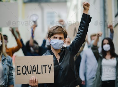 Group of people activists protesting on streets, women march and demonstration concept.