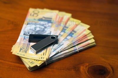 Australian dollars and nano wallet on the desk