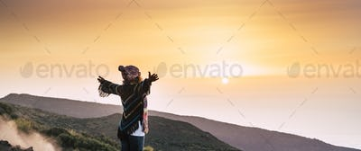 Freedom and hope concept with happy woman enjoying nature sunset