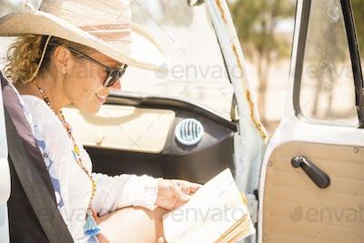 Happy cheerful woman travel inside a  van