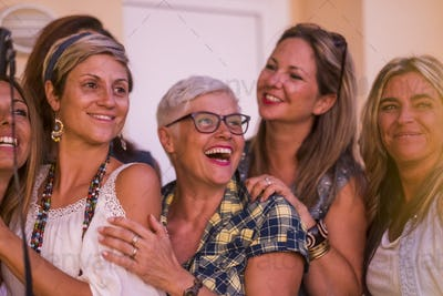 Group of mixed age lady have fun together in friendship