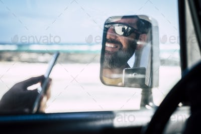 close up of young man travel with car