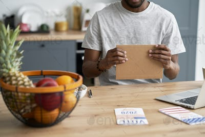Black man voting by mail