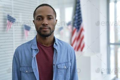 Portrait of serious black man in ballot place