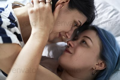 Close up of romantic lesbian couple in bed