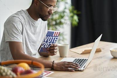 Man browsing informational leaflet of election