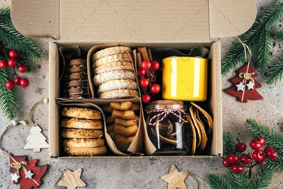 Christmas cookie gift box. Assorted shortbread cookies with holiday decoration.