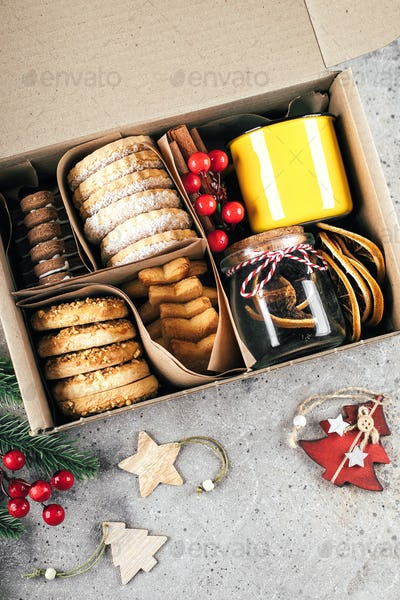 Christmas cookie gift box. Assorted shortbread cookies with holiday decoration. Care package concept