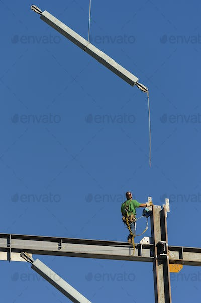 Low angle view of construction worker on scaffolding