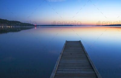 Wooden dock over still lake