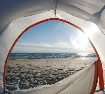 Open camping tent door on beach