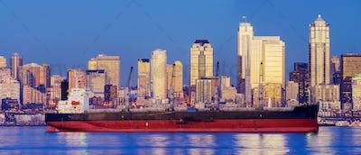 Freighter near cityscape, Seattle, Washington, United States